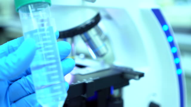Scientist and bio lab experiment and slow motion shot video