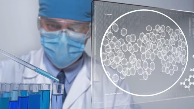 科学者と未来的な技術 - タッチスクリーン点の映像素材/bロール
