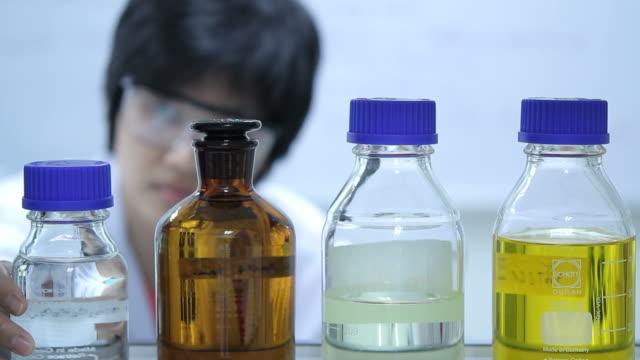 Scientist checking chemistry video