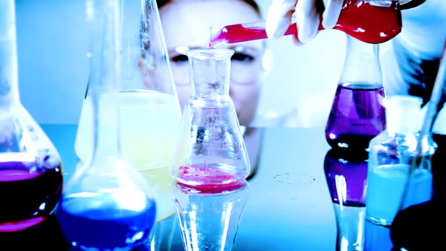 Scientist classifying liquid sample in a laboratory video