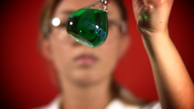 Scientist Experimenting with Green Liquid video
