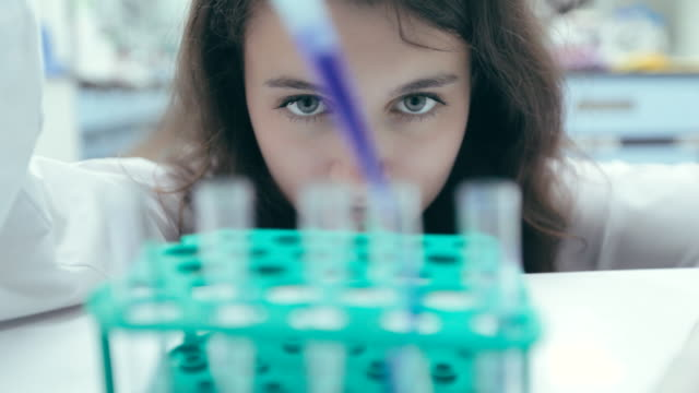 Scientist finding a cure in laboratory, Concept science and technology , Research in the laboratory, slow motion video
