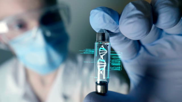 A scientist in his laboratory holds a test tube containing DNA and is able to control the evolution of man thanks to holography.
