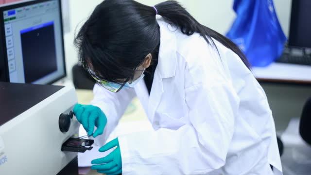 Scientist in laboratory video