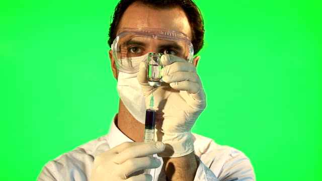 Scientist injecting blue liquid into bottle video