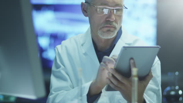 Scientist is Using Tablet in Laboratory – Video