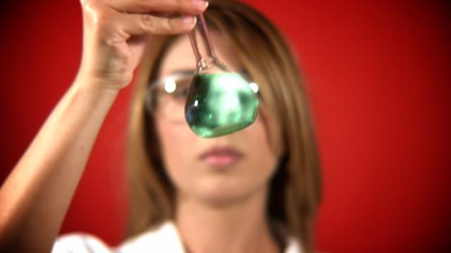 Scientist looking at Green Glowy Liquid video