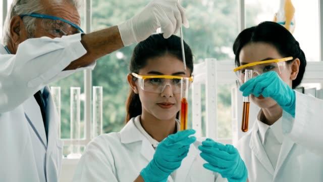 Scientist using a pipette in laboratory
