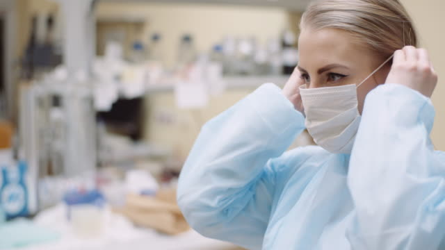 scientist wearing protective mask at laboratory - indumento protettivo video stock e b–roll