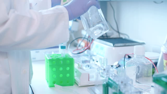 Scientist working in a hospital medical laboratory conducting experiments video