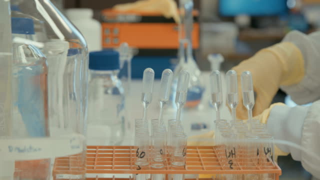 Scientist working in a pharmaceutical laboratory conducting experiments video