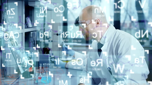 Scientists analyze the periodic table elements Scientists analysing the elements of the periodic table. Recorded with RED EPIC. Color correction professionally done. 4K available stem research stock videos & royalty-free footage
