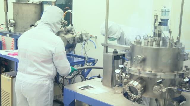 Scientists in modern laboratory video