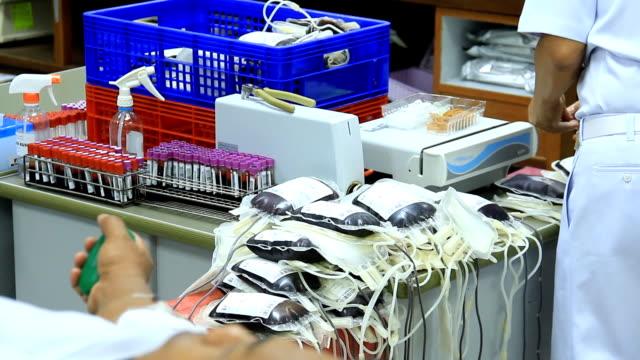 Scientists loading sample vials into centrifuge. video