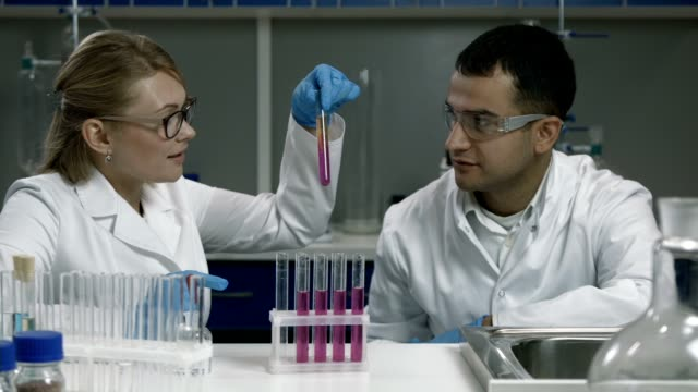 Scientists making research in chemical laboratory video