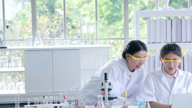 Scientists teamwork brainstorming with research laboratory in lab