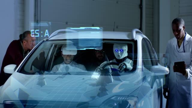 scientists testing a car driving robot - голографический стоковые видео и кадры b-roll
