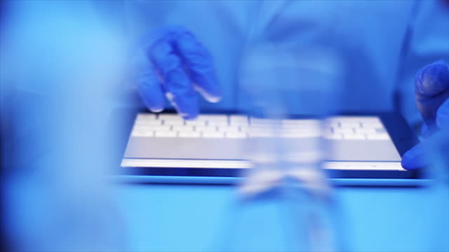 Scientists using tablet in the laboratory video