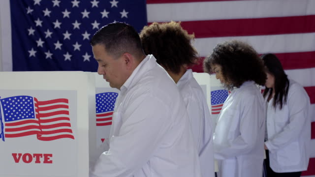 Scientists voting at booths in polling station video