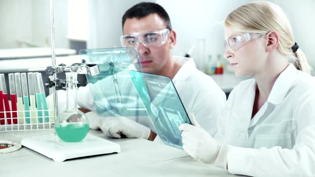Scientists working in a chemical laboratory. video