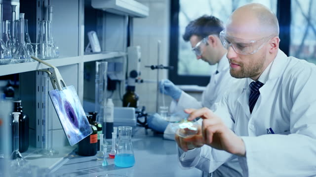 scientists working in a laboratory - bio tech stock videos and b-roll footage
