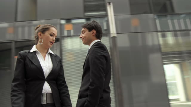 HD SLOW-MOTION: Scolding An Employee HD720p: SLOW-MOTION of a businesswoman scolding an employee while they stand in an urban environment. Spinning point of view. ignoring stock videos & royalty-free footage