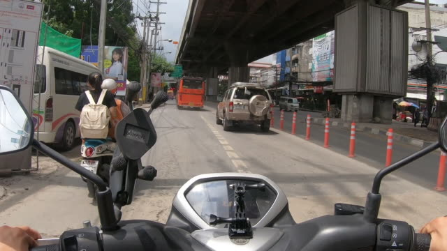 POV scooter : riding on bangkok street with a traffic jam. POV scooter : riding on bangkok street with a traffic jam. handlebar stock videos & royalty-free footage