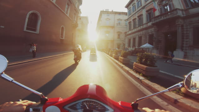 POV scooter riding: on the motorbike in the center of Rome POV scooter riding: on the motorbike in the city of Rome handlebar stock videos & royalty-free footage
