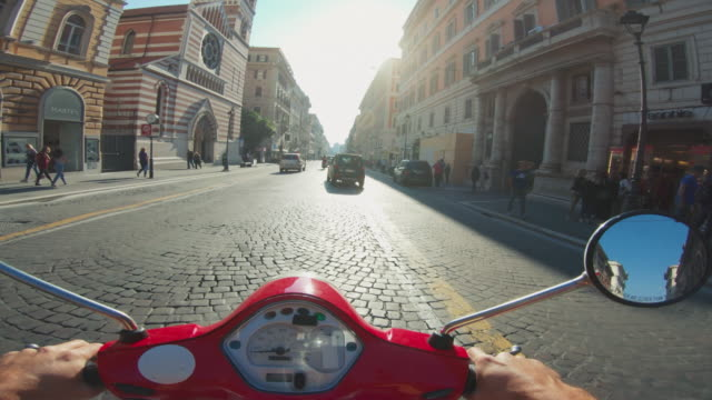 POV scooter riding: on the motorbike in the center of Rome
