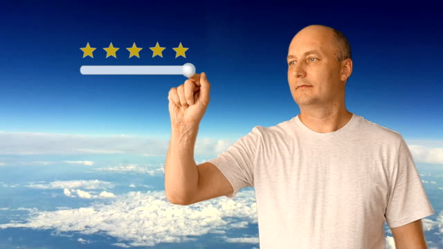 Score of 5 stars on a virtual screen. The man moves his finger on the virtual screen. Against a blue sky with clouds on a sunny day. The white man shows satisfaction.
