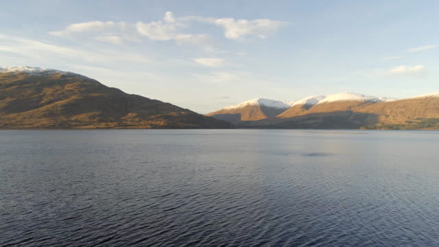 scottish loch and trees in the winter - fort william video stock e b–roll