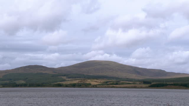 Scottish loch in Dumfries and Galloway , south west Scotland shot in late summer 4k footage shot at 50fps and interpreted at 25fps to give a slow motion dumfries and galloway stock videos & royalty-free footage