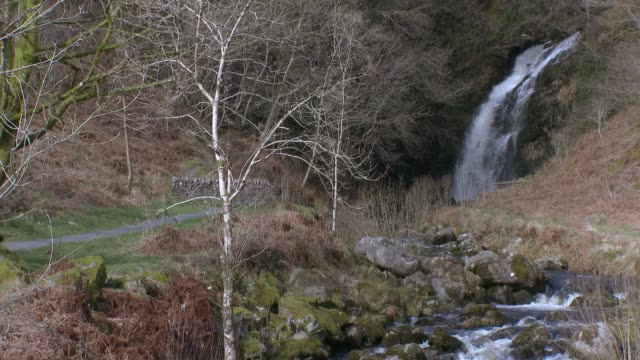Scottish waterfall in Dumfries and Galloway south west Scotland 4K footage shot at 59.94fps and interpreted to 23.976 to give slow motion dumfries and galloway stock videos & royalty-free footage