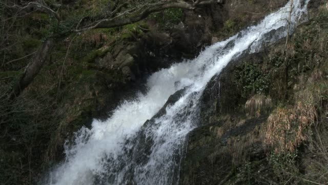 Scottish waterfall in Dumfries and Galloway south west Scotland 4K footage shot at 59.94fps and interpreted to 23.976 to give slow motion galloway scotland stock videos & royalty-free footage