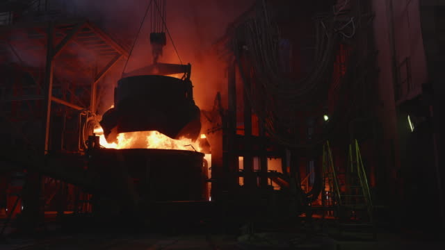 Scrap metal being poured into an Electric Arc Furnace at a Steel Factory Steel, Factory, Business, Industry, Africa - Scrap metal being poured into an Electric Arc Furnace furnace stock videos & royalty-free footage