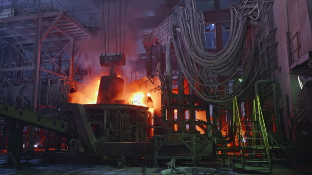 Scrap metal being poured into an Electric Arc Furnace at a Steel Factory