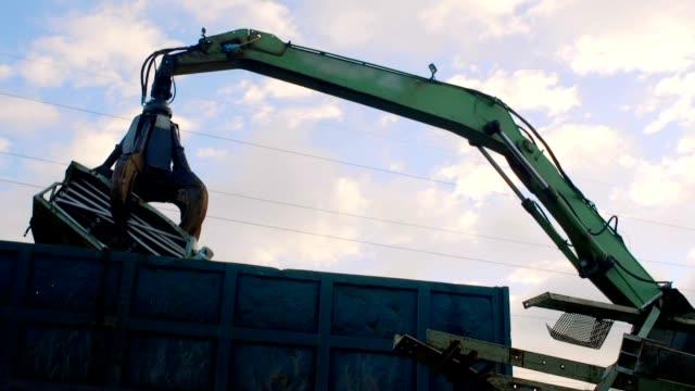 Scrap metal recycling plant and crane video