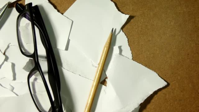 Scrap paper and pencil, pen, glasses video