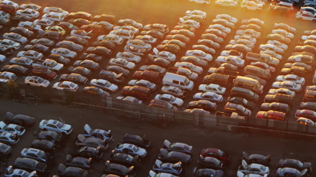 Scrapyard Grid - Drone Shot Aerial shot of rows and rows of old cars in a scrapyard large group of objects stock videos & royalty-free footage