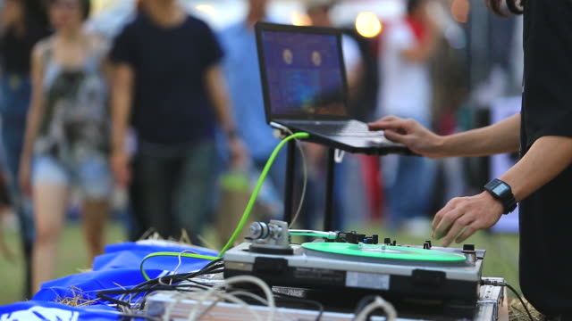DJ  Scratches and Mixes with computer video