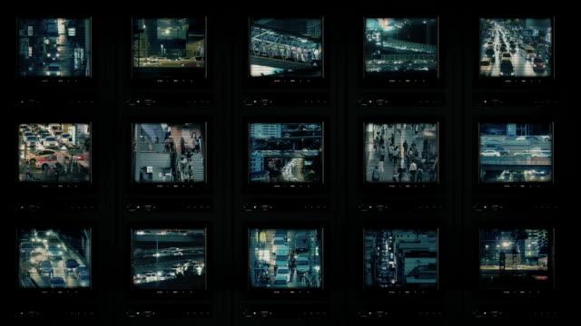 vídeos de stock e filmes b-roll de cctv screens showing city at night - tv e familia e ecrã