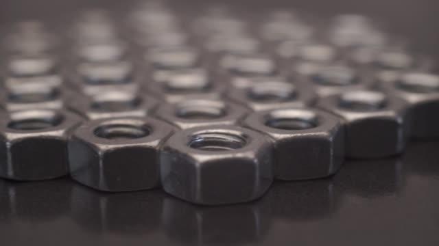 screw-nut rotation 360 degrees. macro view. - винт стоковые видео и кадры b-roll
