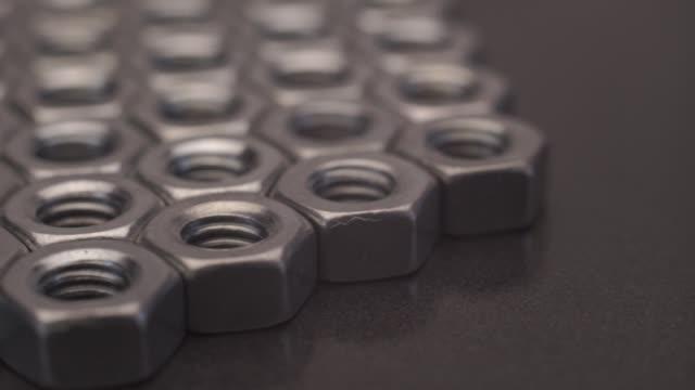 screw-nut rotation 360 degrees. macro view. - затягивание стоковые видео и кадры b-roll