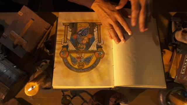 HD: Scribe Examining His Book
