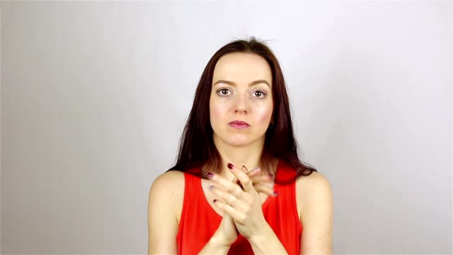 Scristically clapping her hands. Young beautiful woman applauding video