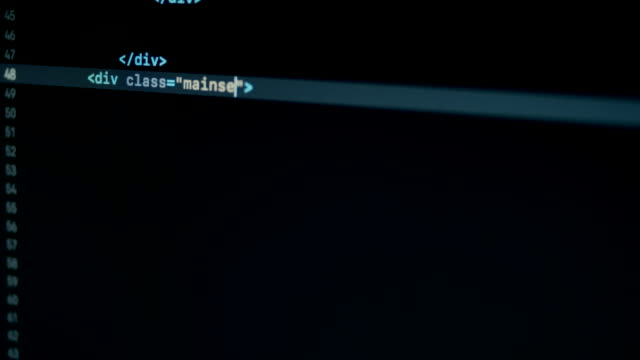 Scroll and type HTML programming code on laptop screen