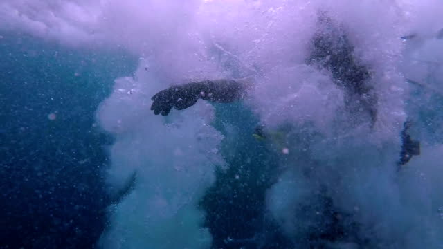 Scuba Diver Jumping into the Ocean In slow motion a scuba diver jumps into water. aqualung diving equipment stock videos & royalty-free footage