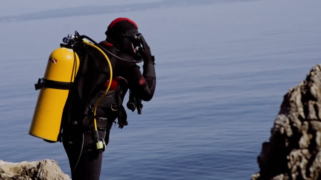 Scuba Diver Preparing for Dive stock video Portrait of a diver in black stock video aqualung diving equipment stock videos & royalty-free footage