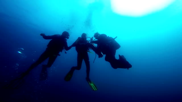 Scuba Diver Rescue Simulation Rescue divers learning rescue techniques in open waters. aqualung diving equipment stock videos & royalty-free footage