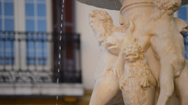 Sculpted figures of god Neptune in public fountain in Malaga, Spain video